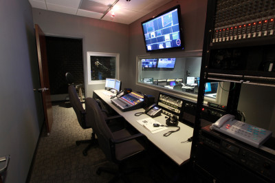 Audio control with recording & playback, VO booth, wireless mics, IFB, and Gentner phone system.