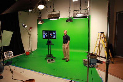 Phil Simms demonstrating Aetrex foot scanning technology on green screen